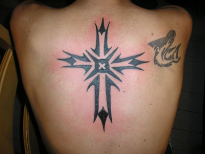 One can get a small cross tattoo anywhere on the body and hide it to